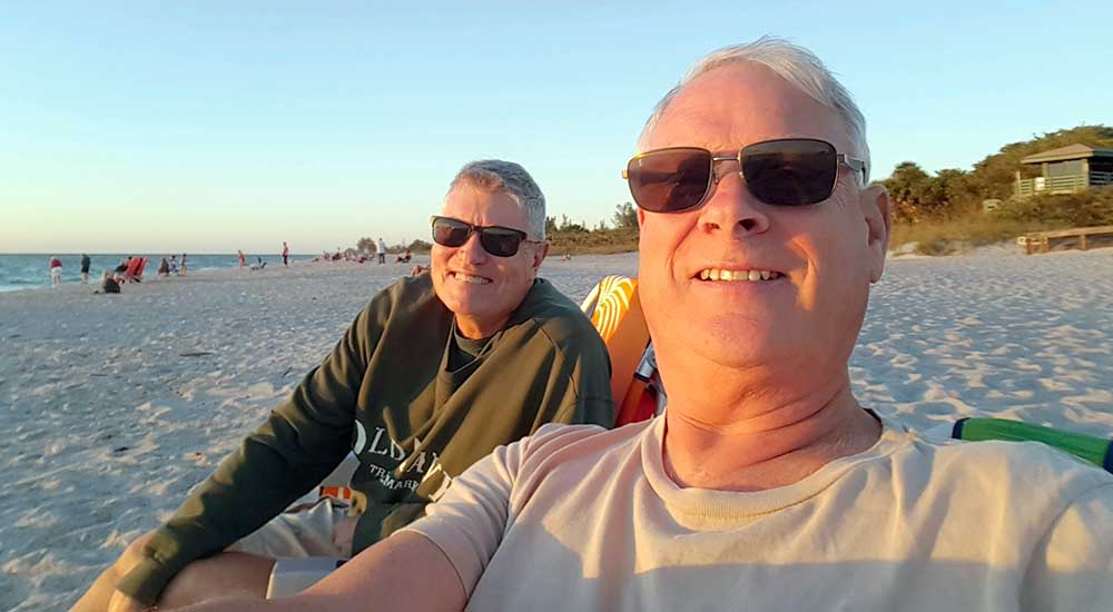 Two men on a beach in Florida, formerly depressed