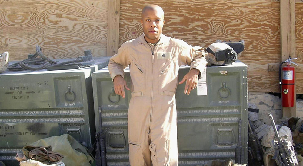Veteran standing with shipping crates