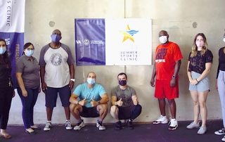 Eight people in a gym wearing masks