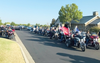 Long line of motorcyclists in a column